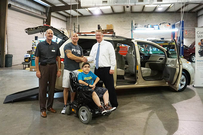 Scott Shelby, MobilityWorks of Tampa General Manager, congratulates Joe Wilcher and his son Austin.